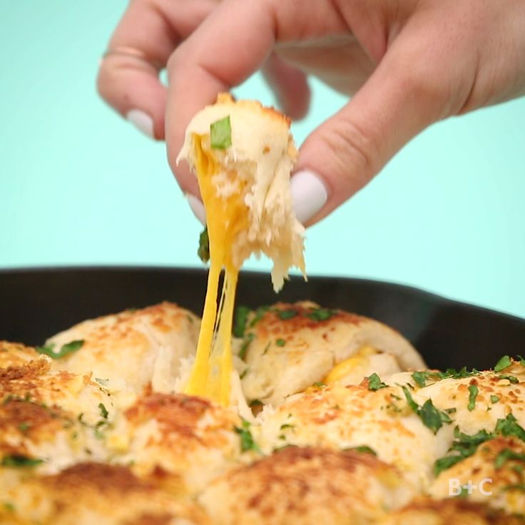 Make Cheesy Garlic Bombs as a tasty bite-sized appetizer for your next party with this easy video recipe DIY tutorial.