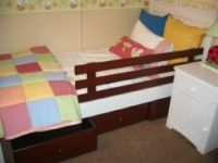 single bed with guard rail and under drawers with matching side table