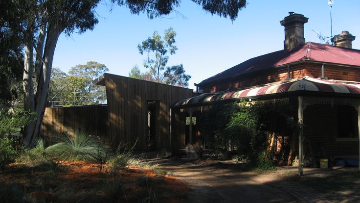 New Addition facing Seven Creeks with facade expressing recycled redgum cladding recovered from bridge timbers.