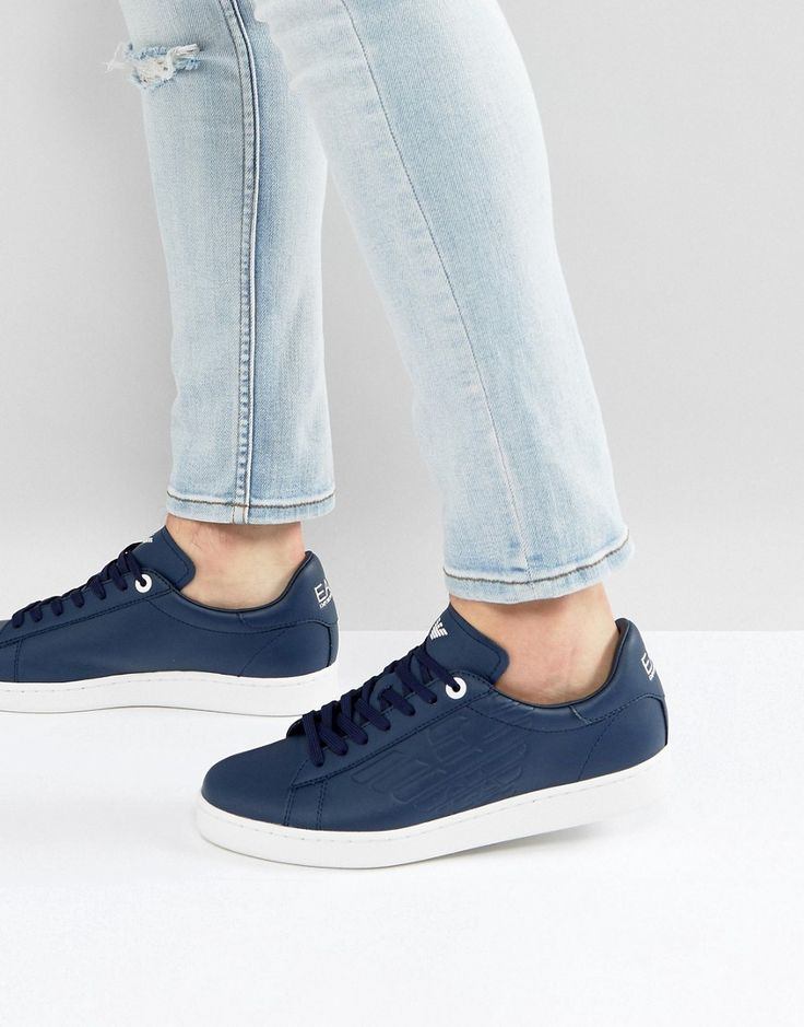 Get this EA7's sneakers now! Click for more details. Worldwide shipping. EA7 Embossed Eagle Logo Trainers in Navy - Navy: Trainers by EA7, Leather upper, Lace-up fastening, Branded tongue and cuff, Padded for comfort, Chunky sole, Moulded tread, Wipe clean, 100% Real Leather Upper. Launched in 2004 as an offshoot of Emporio Armani, EA7 takes the best from functional clothing and combines it with street style in its relaxed staples. Prioritising natural fibres, lightweight fabrics and a close…