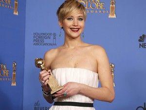 Jennifer Lawrence vence o prêmio de melhor atriz coadjuvante no 71º Globo de Ouro, que acontece neste domingo (12), em Los Angeles. (Foto: REUTERS/Lucy Nicholson)