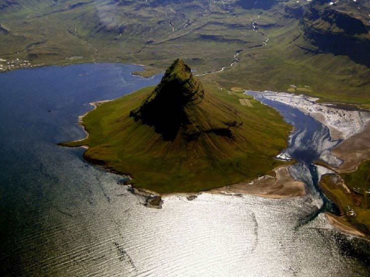 How cool is this island mountain called Kirkjufell in Icelend? Okay its technically attached to mainland but you must admire the roundness and uniform shape. It's like a giant sombrero hat mated with a pyramid.