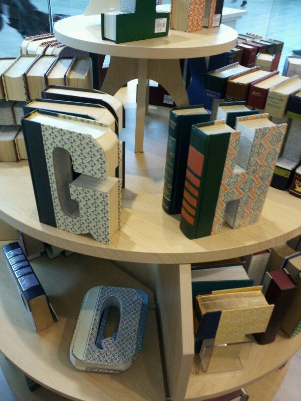 Readers Digest books cut into letters.