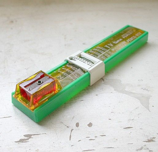 plastic pencil box with sharpener and sliding multiplier/divider !! :)