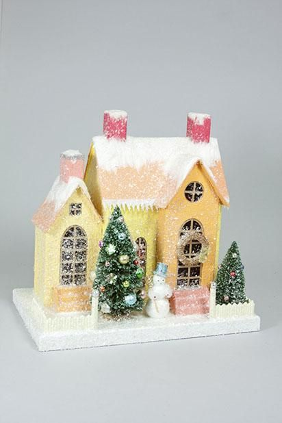 Putz Houses, remind me of Grandma's Christmas village on top of her piano. <3