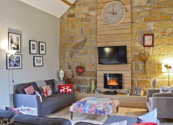 Feature stone wall in lounge of Swallow Holiday Cottage, Castleton. www.iknow-yorkshire.co.uk