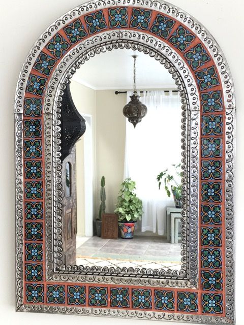 825mm high x 680mm wide.  A gorgeous hand punched tin mirror with hand made ceramic talavera tiles from Mexico.   Not available to be couriered sorry, due to fragile mirror glass.