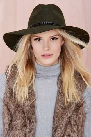 A wide brimmed hat is a flattering style for women who enjoy wearing their hair out or tied to the back or side softly. A shorter brim option may suit a shorter hair style with less drama. The hat will be more of a statement with a sleek hair style or an easy way of controlling winter hair and looking casually stylish with loose hair styles.  Photo credit: thegloss.com