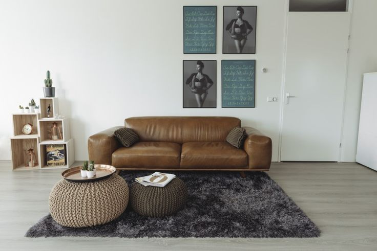 The 3 seater Otto's solid wood base and angled legs make for a distinctly mid-century silhouette.