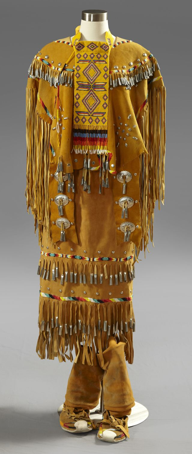 Apache Girl's Ceremonial Two Piece Puberty Dress, 20th c., composed of beaded hide with long fringe, with steel studs and tin cones, consisting of a top and skirt, along with a beaded cravat, Top- H.- 30 in., Skirt- H.- 33 in.