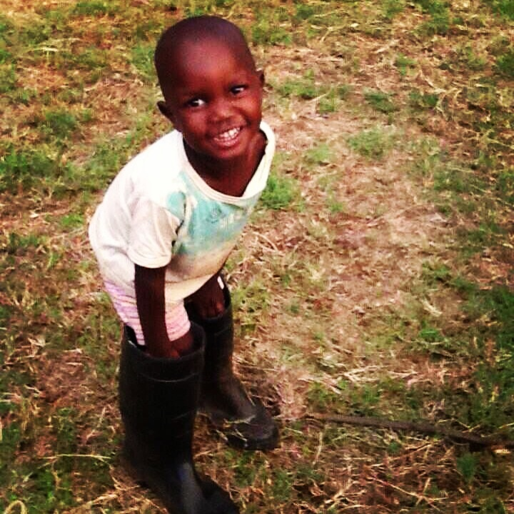 The gorgeous and very funny Fidron 'borrowing' some gumboots for a play at the Suluhisho Childrens Village. Find out more at www.suluhisho.com