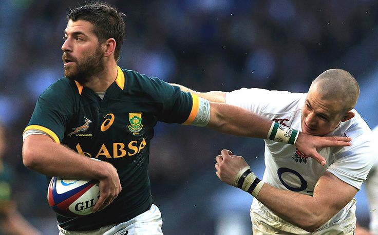 Willie Le Roux offloads despite a challenge from England's Mike Brown