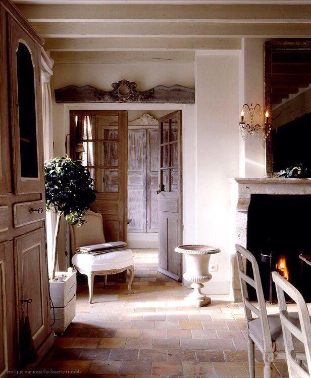 Doors, multiple cornice elements, stone floors.