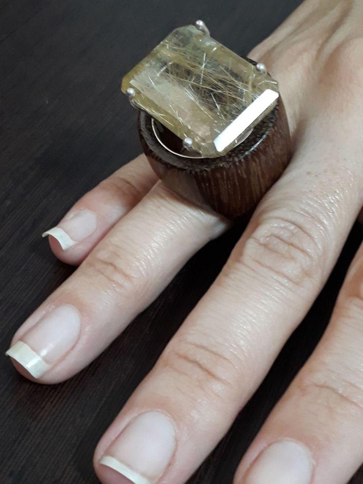 a rutilated quartz and sucupira wood ring  by kingwoodbrazil