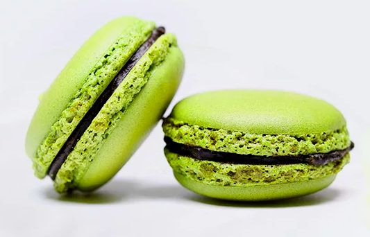 Sweet Matcha Macarons with Adzuki Filling!  A twist on cultures, this Macaron recipe combines French confectionary with Japanese flavors. Matcha and Adzuki beans are known to bethe peanut butter and jelly of each other, rocking a savory, earthy, and sweet profile. Try out these delicious macarons and you'll absolutelyfall in love with this culinary combination! Let's check out the recipe! Ingredients: For the Macaron Shells - Almond flour... 1 cup almond flou...