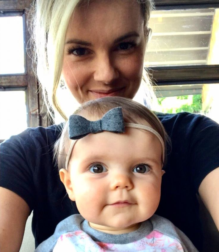 former bachelorette, Ali Fedotowsky and her precious daughter Molly : Molly is wearing our gray felt bow headband : Roses and Polkadots Boutique