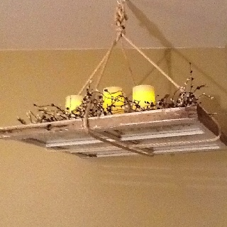 Another great way to use old window panes. The candles are on timers. It's a great way to fill a corner.