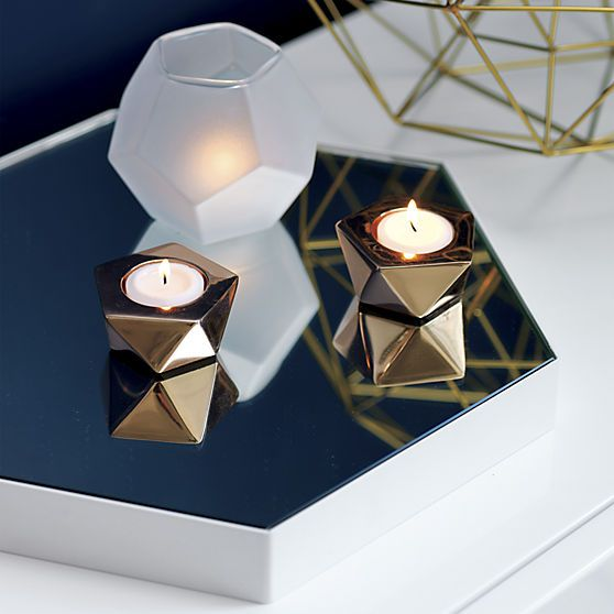 Handmade of translucent white glass, geometric vessel reflects a luminous glow from every facet.