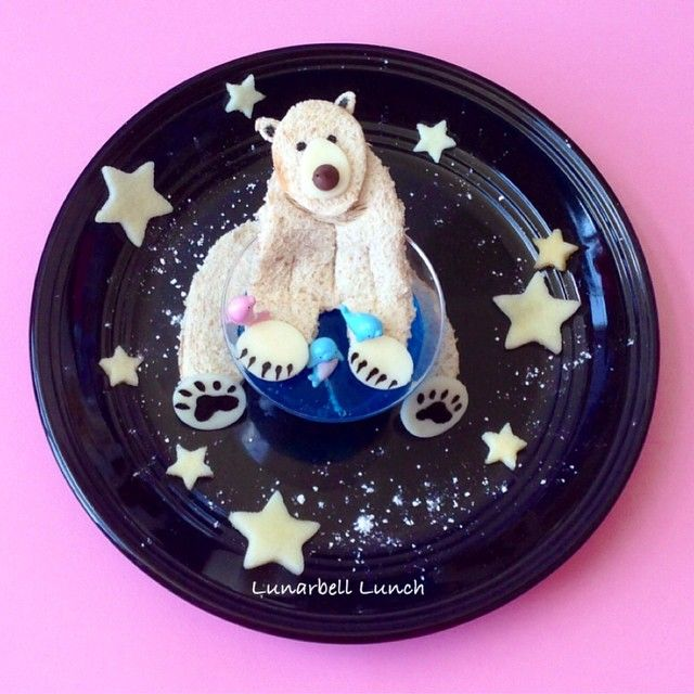 A polar bear was requested today so here he is! He is night fishing! LOL! I made the polar bear out of a PB sandwich and some mozzarella cheese details. The fishing hole is some blue jello and I also included some apple stars.