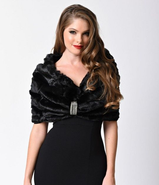 In need of a divine drape? Add some vixenish vintage style glamour to any evening dress with this stunning faux fur shrug! A adjustable snap button faux leather clasp is sparkling with silver rhinestones and can be fastened to any area of this pull on des