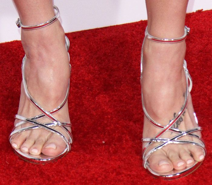 Ashley ices up the red carpet in a pair of metallic Stuart Weitzman sandals