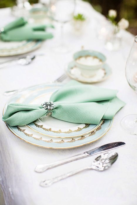 A napkin tucked into a jeweled napkin holder adds elegance to a table setting. Via Seriously Sabrina Photography. #tablenapkins #napkinfold