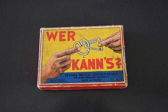 For sale is a very cool vintage (likely 1950s) set of metal patience puzzles from Germany. Included in the cardboard box are 7 different metal shapes that need to be disentangled. The manufacturer is Spears and the box reads Who can do it? Spears Metal Patience Puzzles includes detailed