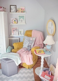 Lovely neutral grey nursery with tose smoke accents. Soft and pretty. Love the framed book covers on the shelf! | On to Baby Blog
