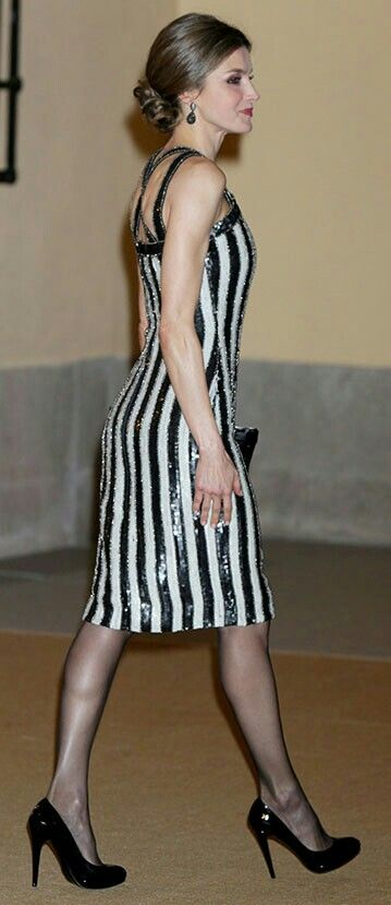 Queen Letizia - black and white striped sequined number with strap detail - Burberry studded clutch bag - Magrit pumps
