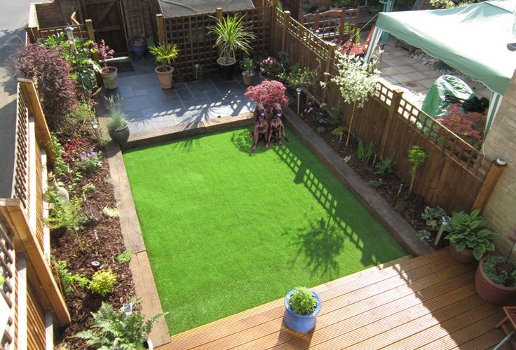 Bodgan and Branston on their artificial grass play area
