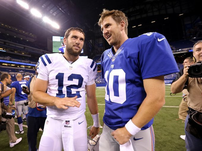 Indianapolis Colts Andrew Luck,left, talks with NY Giants Eli Manning,right, at the end of their preseason Saturday, August 16, 2014, evening at Lucas Oil Stadium.