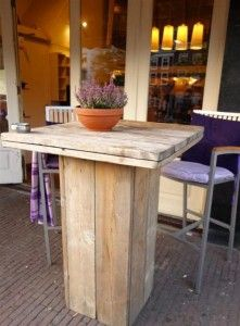 Table made from repurposed wood pallets could be used indoors or out.  This was part of a display at the 2013 Planterium show in Holland.