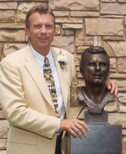 Joe Montana, 4 Lombardi trophies. I had a huge crush on him when I was younger.
