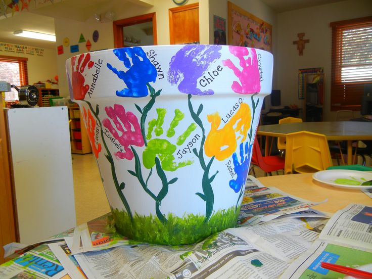 We just made this handprint flower pot today with the 3 year old preschoolers at St. John the Evangelist School for our silent auction. Quite happy with how it came out!