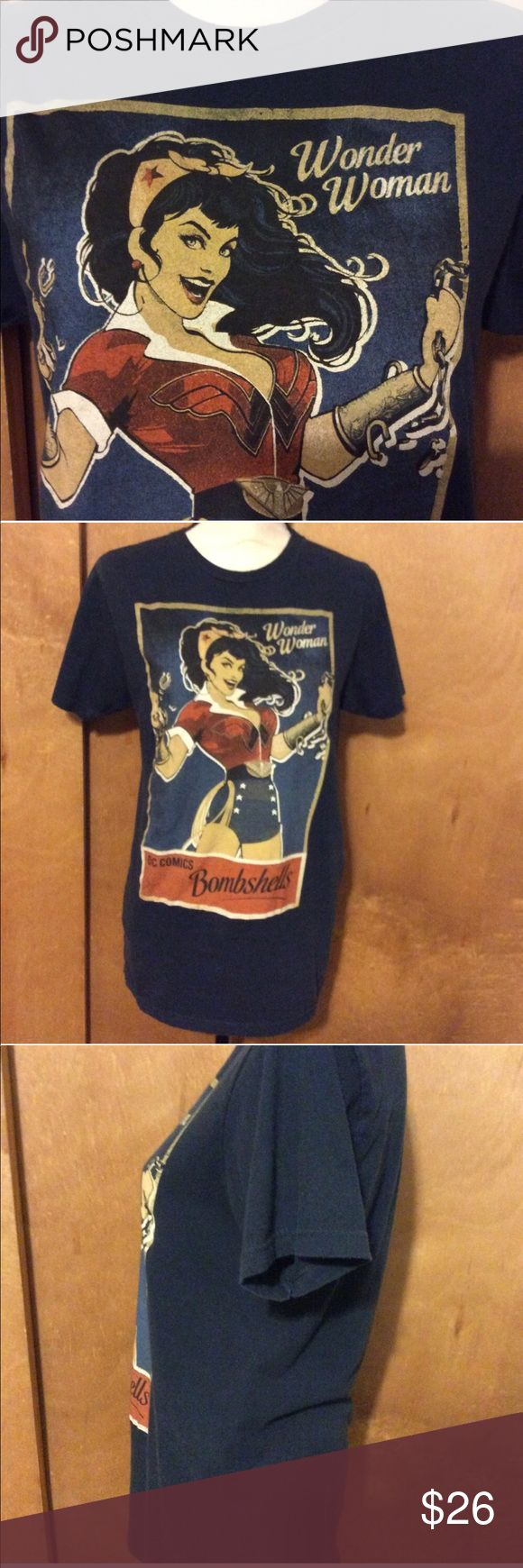 ~Navy~ DC Comics Vintage Wonder Woman Tee 'DC Comic Original' Tee in gold, white, red, rust and black on navy background. There is some cracking of design at bottom and a few small lighter spots on low back both to be expected on a T shirt this old. Bust 18 inches, 27.5 inch long with a 7 inch sleeve.  Thanks for breezing through my closet! ✨💜Roni H/ssa DC Comics Tops