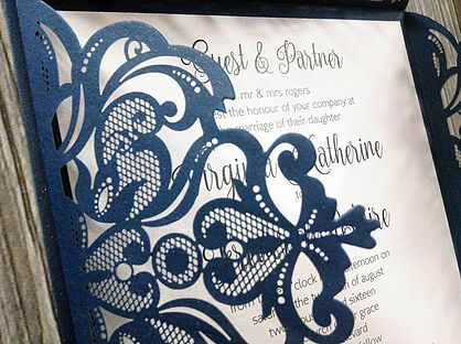 Exquisite laser cut vintage lace petal shown in glittering navy with printed invitation insert featuring pretty script font on white shimmer card x