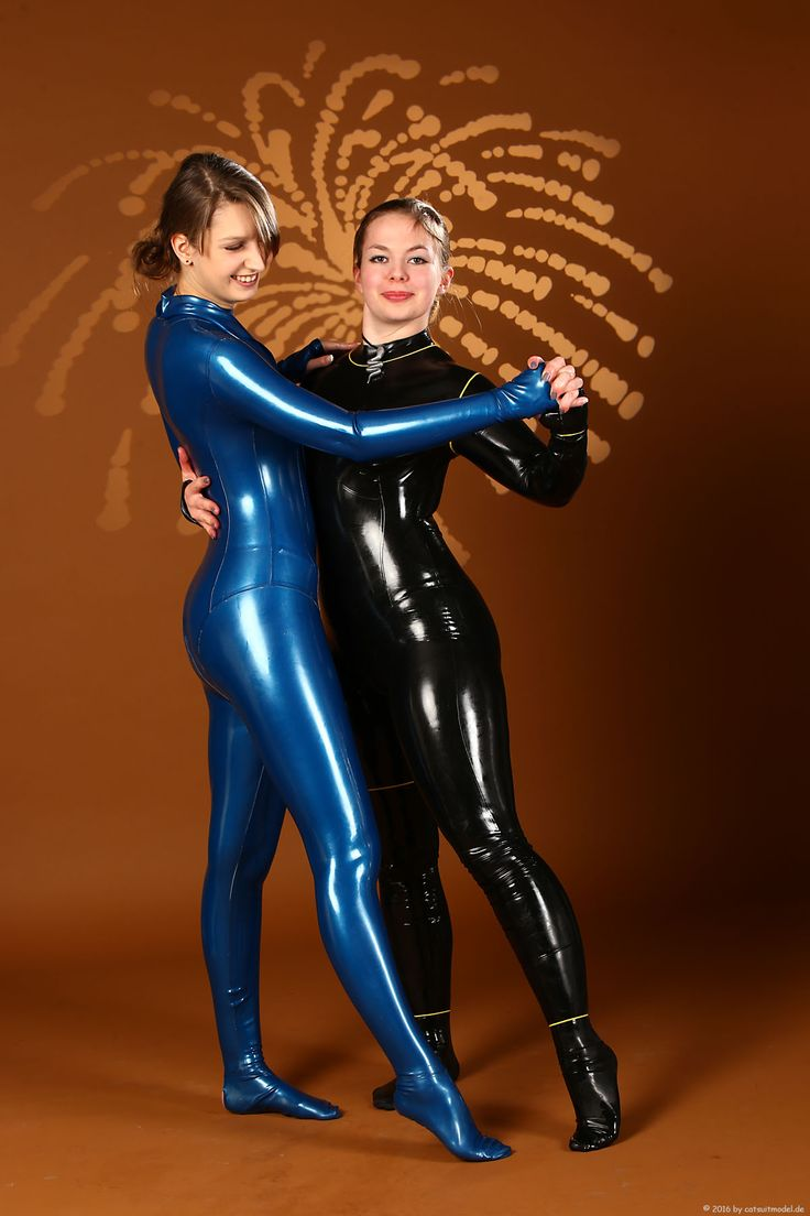 Friends dance wearing latex catsuits without shoes ...