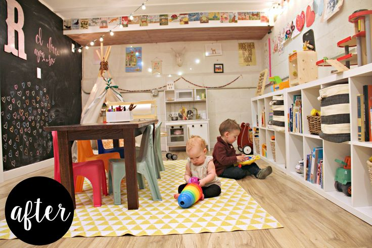 We transformed a neutral basement spaceinto a colorful playroom for our toddlers. We used many items that we already had on hand and lots of organization to create acozy,whimsical space to enjoy the winter months. We painted one wall with chalkboard paint, strung up some outdoor cafe lights and hung some art on the walls.