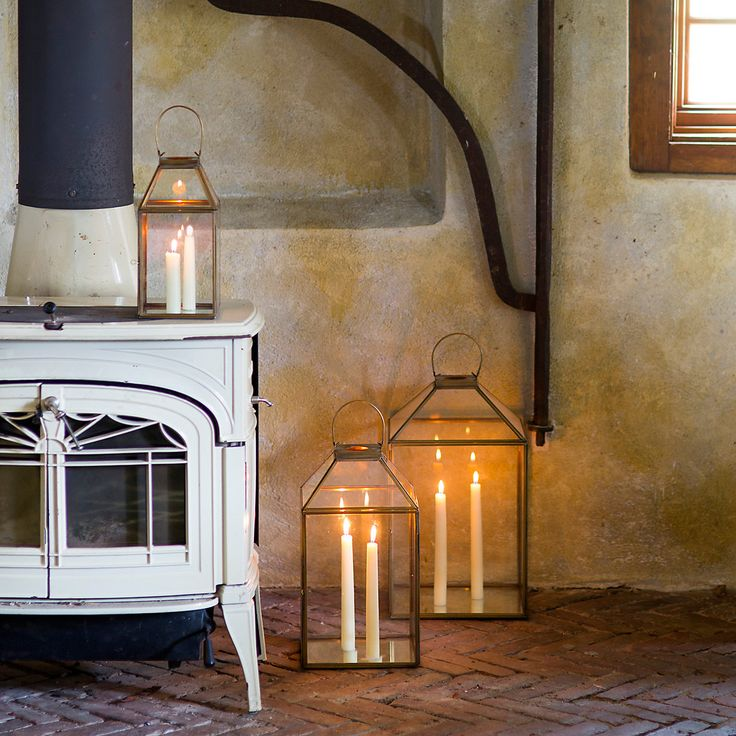 """A slim, brass frame adds polish to this airy lantern with a mirrored bottom and mansard-style roof.- Brass, glass- Do not expose to moisture- Indoor use only- Hanging hardware not included- ImportedSmall: 11""""H, 5.5""""W, 5.25""""LMedium: 15""""H, 8.25""""W, 8.25""""LLarge: 18""""H, 10.25""""W, 10.25""""LImportant: Use only one candle per lantern (8""""H max) and do not leave unattended. Extinguish candles by snuffing flame; do not drop any objects, including matches, onto candle. Lantern may get hot; let cool before…"""