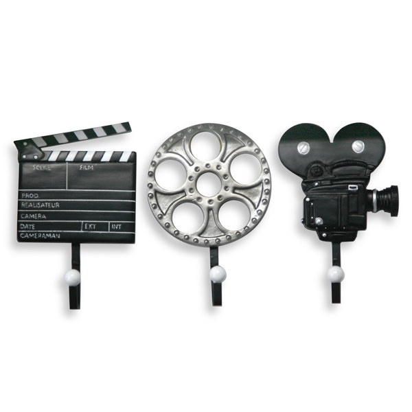 "Movie Plaque Hooks      These cool hooks shaped like a clapboard, film reel and old movie camera will be perfect to add to a movie-themed room or lend a whimsical touch to any decor. Each hook measures 7"" W x 12"" L.     I have these for my new apartment!!!"