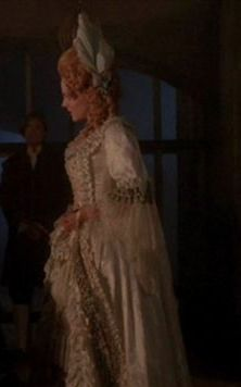 In the middle of the 18th century, Darla takes Angel to see the Master. Nice job disguising a well-trimmed piedmontaise as a française. Could do with fluffier engageantes. The ostrich feather feels a little too 1770s, but feathers had been worn in the hair before. Hairstyle looks 1760s; white foundation makeup with bright red cheeks is a French influence and period-accurate. The folding fan is a nice touch.