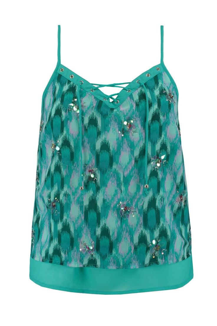 Deze feestelijke blouse top heeft verstelbare spaghetti bandjes. Dit model is dubbel laags en de stof is van een soepel vallende kwaliteit. De bovenlaag is korter dan de onderlaag en het materiaal met print is verrijkt met pailletjes.Het veterdetail maakt deze blousetop helemaal uniek! Lengte: 42 cm in maat L Pasvorm: Losvallend Wasvoorschrift: Machinewas
