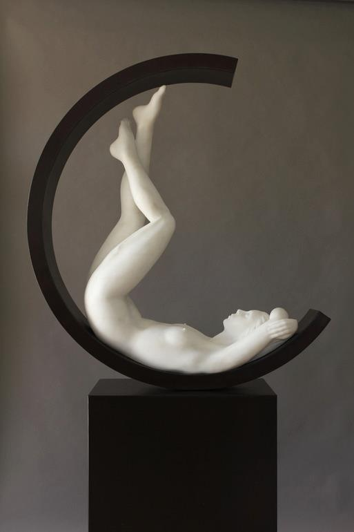 balance: asymmetrical. this sculpture uses asymmetry because the two sides are not overlapping or similar