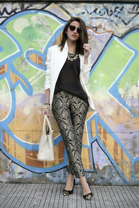 white blazer black top printed pants