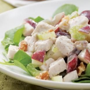 Chicken Waldorf Salad -      1/3 cup low-fat mayonnaise     1/3 cup nonfat or low-fat plain yogurt     2 teaspoons lemon juice     1/4 teaspoon salt     3 cups chopped cooked chicken breast (see Tips)     1 medium red apple, diced     1 cup halved red or green grapes     1 cup sliced celery     1/2 cup chopped walnuts, toasted if desired (see Tips), divided