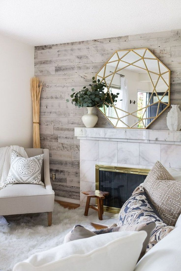 White living room, fireplace, wood accent wall