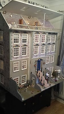 unique dolls house | eBay (sold) Victorian Hand Made one off 120x 116 x 78cm 12 large rooms + 3 in attic Fully decorated, lights, light up fires. Lit lamp post on lawn. Chandelier is real crystal Complete family, pets, servants.