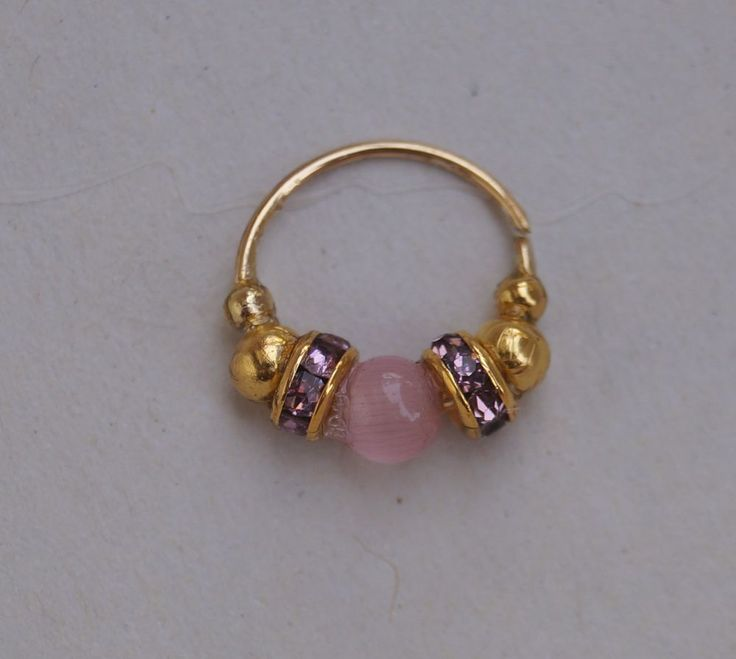 Pink and Purple! You can get this also blue and green.... Nose ring, Nostril, Septum, where you need it! 8 mm, 22 gauge, Czech Crystals, Cat Eye bead and golden beads