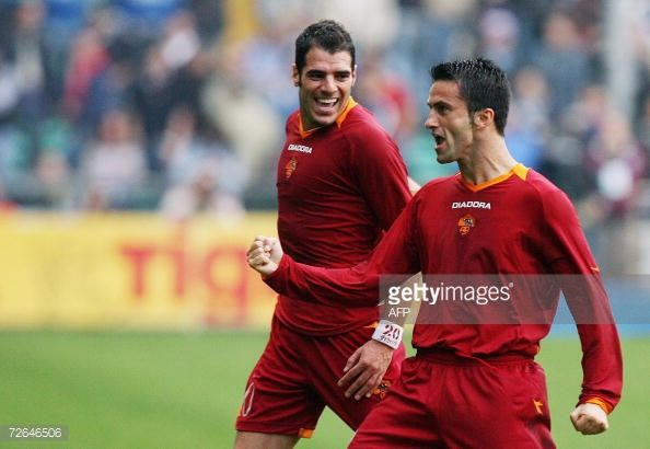 Roma's defender Christian Panucci is congratulated by his teammate Simone Perrotta after scoring a goal against Sampdoria during their Serie A...