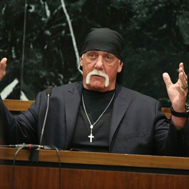 Hulk Hogan, dressed as if (to quote Trevor Noah) he's going to a funeral for a boa constrictor...